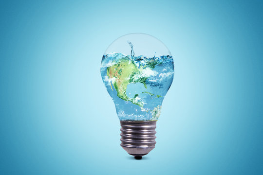 Light bulb with world globe and water