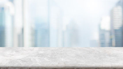 Empty white stone marble table top and blurred abstract background from interior building in city banner background - can used for display or montage your products.