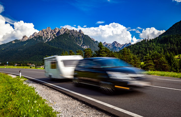 Family vacation travel, holiday trip in motorhome RV, caravan car motion blur