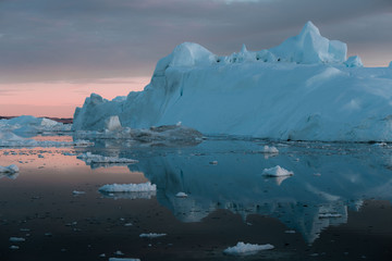Floating Iceberg in Greenland during sunset