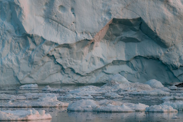 Close up of Floating Iceberg in Greenland during sunset