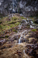 waterfall water stream with ice and frost