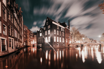 Amsterdam, canals and buildings at dusk, Netherlands.