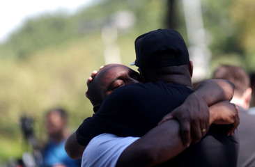 Cristiano Esmerio, father of goalkeeper Christian Esmerio, 15, reacts during his funeral after a deadly fire at Flamengo soccer club's training center, in Rio de Janeiro