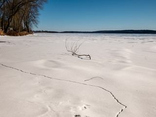 cracks in the ice of a frozen lake