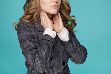 Women thyroid gland control. Sore throat of a people isolated on Blue background.