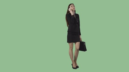 d8c605984ae 0:22 Sexy business woman in short skirt is strolling an talking by phone.  Alpha channel