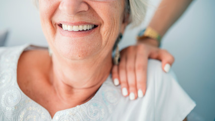Sign of caring for seniors. Helping hands. Care for the elderly concept.