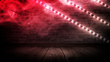 Illumination of an empty brick wall, neon light, smoke. The night scene of an empty room is decorated with abstract light. Night smoke.