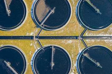 Sewage farm. Static aerial photo looking down onto the clarifying tanks. Industrial place. Geometric background texture. Photo captured with drone.