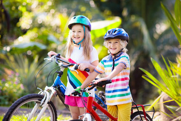 Kids on bike. Children on bicycle. Child biking.