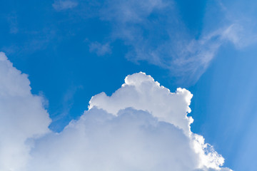 Close up view on a white cumulus fluffy clouds in blue sky