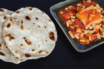 Famous Indian dish: paneer butter masala spicy curry dish.