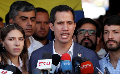 Venezuela's Guaido takes part in religious event in Caracas