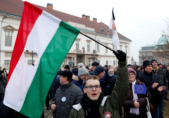 People protest after Hungarian Prime Minister Viktor Orban delivered his annual state of the nation address in Budapest