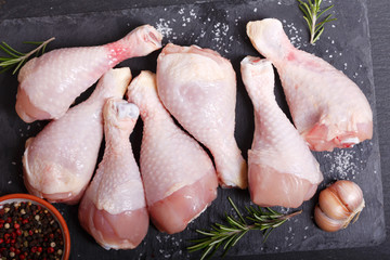 fresh chicken meat with ingredients for cooking, top view