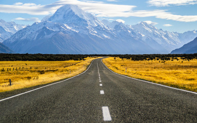 Beautiful Scenic landscape panoramic view of the empty road and the highest mountain of New Zealand - Aoraki/Mount Cook on background. Tourist popuar destination in South Island.