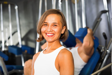 Woman taking break and sitting on bench during workout