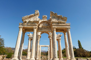 The Tetrapylon (monumental gate) at an archaeological site of Helenistic city of Aphrodisias in  western Anatolia, Turkey.