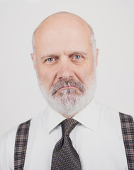 Disappointed senior man on white background