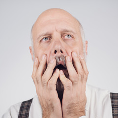 Frustrated mature man feeling tired and hopeless