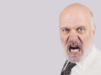 Angry mature man shouting at the camera