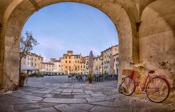 Lucca, Italy. View of Piazza dell'Anfiteatro square through the arch