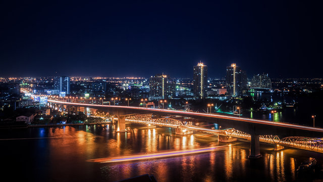 Urban Night Scene Skyline Bright Lights Bridge River Generic City Landscape