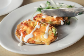 Baked potatoes with cheese topping