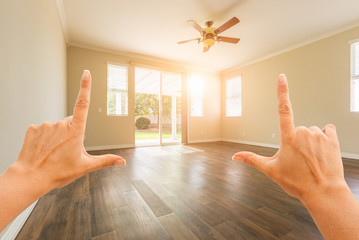 Female Hands Framing Empty Room of House