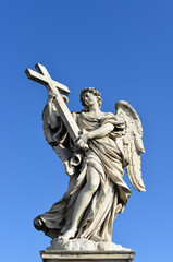 Angel holding the Holy Cross. Sant'Angelo Bridge in the center of Rome