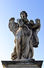 Angel with garment and dice. Sant'Angelo Bridge in the center of Rome