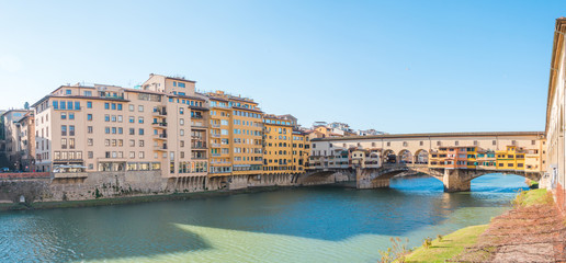 Ponte Vecchio bridge sunny day Panorama view in Florence, Italy