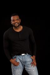 Happy Black man smiling in black shirt