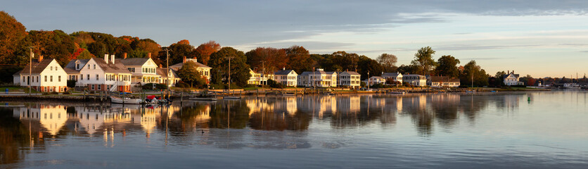 Panoramic view of residential homes by the Mystic River during a vibrant sunrise. Taken in Mystic, Stonington, Connecticut, United States. Wall mural