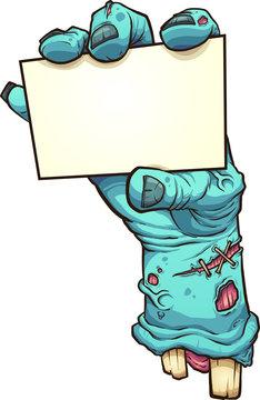 Cartoon severed zombie hand holding a blank card
