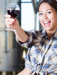Woman posing with a glass of wine