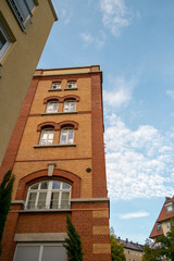 Skyscraper with a facade of bricks against a blue sky