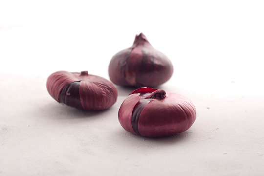 red onions on grey background