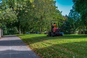 Council motorized grass cutter in park