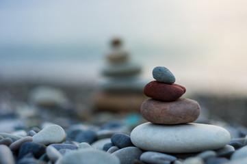 Obraz stack of zen stones on pebble beach - fototapety do salonu