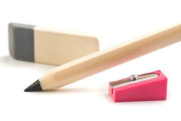 Wooden colorful pencils isolated on a white background, pencil sharpeners.