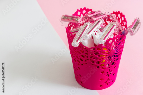 Small Pink Plastic Basket With Several Depilation Blade