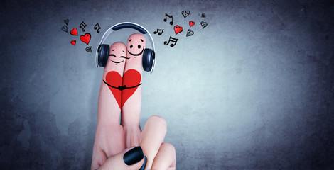 Zwei verliebte Finger mit Kopfhörer