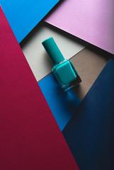 nail polish bottle on geometric pattern background