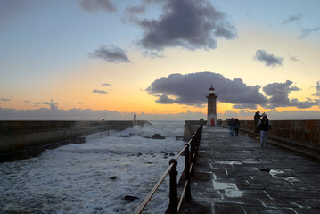 Lighthouse at the Douro mouth in Porto at sunset