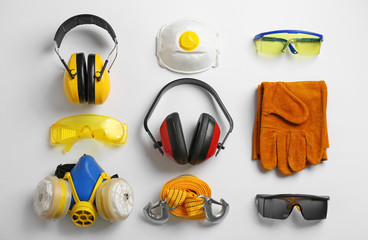 Flat lay composition with safety equipment on white background
