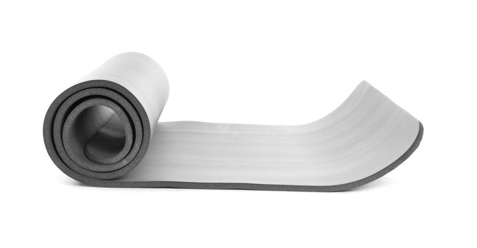 Rolled grey yoga mat on white background