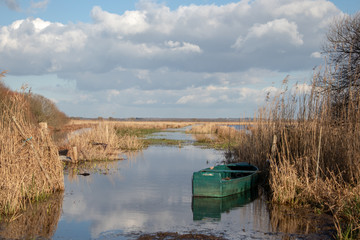 View of some salt marshes with an old abandoned boat