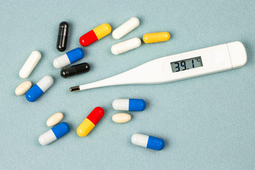 Wall Mural - Thermometer and pills associates with illness and therapy.